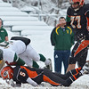 Oakmont quarterback Shamus Gorman is brought down during the Thanksgiving game against Gardner on Thursday morning. SENTINEL & ENTERPRISE / Ashley Green