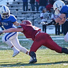 Leominster's Eddie Rivera evades the Fitchburg tackle during the Thanksgiving matchup on Saturday afternoon at Doyle Field. SENTINEL & ENTERPRISE / Ashley Green