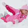 Avery Macaloney, 3, of Maryland, plays in the snow during the Thanksgiving game on Thursday morning. Avery was attending the game with dad Brent, a 1994 graduate of Oakmont. SENTINEL & ENTERPRISE / Ashley Green