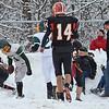 Oakmont's Jake Logan sends Gardner's Dominic Martins into the snow during the Thanksgiving game on Thursday morning. SENTINEL & ENTERPRISE / Ashley Green