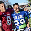 Fitchburg quarterback Darius Flowers and Leominster's Shane Crayton show some love after the Thanksgiving classic on Saturday afternoon at Doyle Field. SENTINEL & ENTERPRISE / Ashley Green