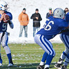Blue Devil quarterback Noah Gray looks for a teammate during the Thanksgiving matchup between Leominster and Fitchburg on Saturday afternoon at Doyle Field. SENTINEL & ENTERPRISE / Ashley Green