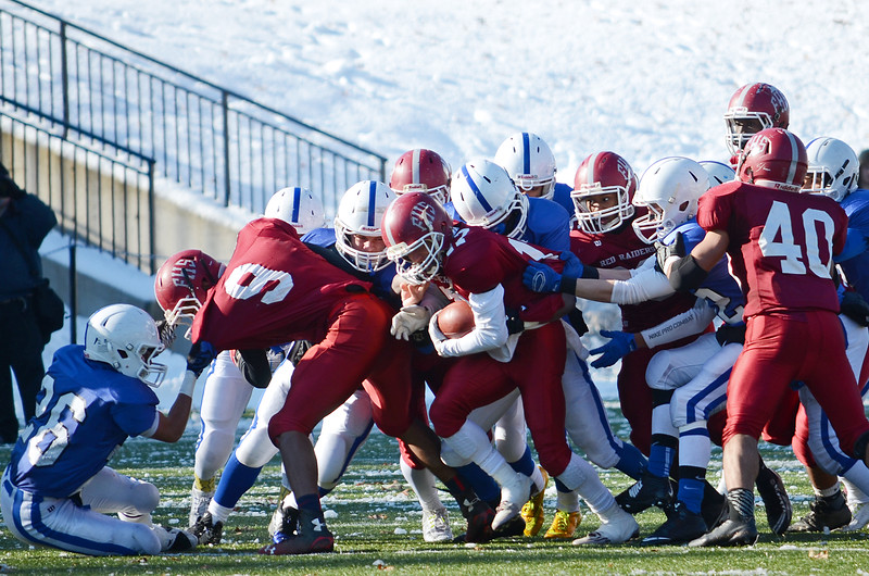 Fitchburg's Nik Myles breaks through the LHS tackle during the Thanksgiving matchup between Leominster and Fitchburg on Saturday afternoon at Doyle Field. SENTINEL & ENTERPRISE / Ashley Green