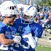 Leominster's Shane Crayton and Jesus Cortes chat during the Thanksgiving matchup between Leominster and Fitchburg on Saturday afternoon at Doyle Field. SENTINEL & ENTERPRISE / Ashley Green