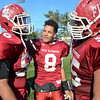 Fitchburg seniors Bruce Johnson, Darius Flowers, and Leonardo Ramirez huddle up after the Thanksgiving classic on Saturday afternoon at Doyle Field. SENTINEL & ENTERPRISE / Ashley Green