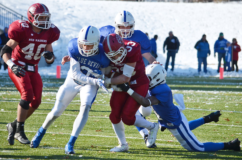 The Leominster defense brings down Fitchburg's Alex Marrero during the Thanksgiving matchup on Saturday afternoon at Doyle Field. SENTINEL & ENTERPRISE / Ashley Green