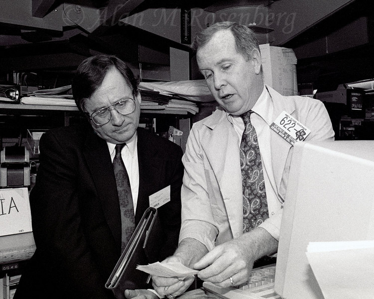 AMEX Floor Governor and Specialist, Dennis Goin (R) displays the opening order to the Chairman of Del Electronics, listed on the AMEX 4/18/1990