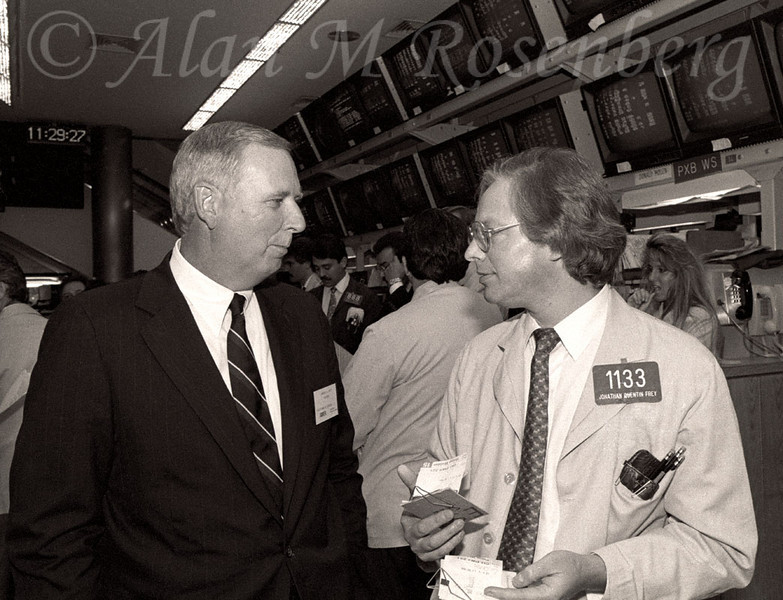 Specialist Jonathan Queintin Frey with the Chairman of Essex Financial Partners, listed at the AMEX  July 17, 1990