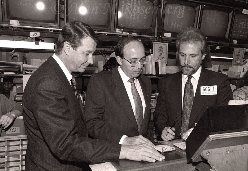 Michael Marchisi (R), Specialist with Aim Securities officiated the opening for the listing of Interstate Financial Services, May 2 1990. Looking in is (L) Porter Morgan, AMEX Senior Vice President along with the Chairman of Interstate Financial SErvices