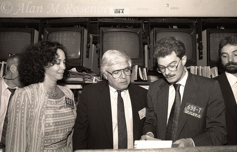 AMEX Specialist Susan Bender (L) and John Jay Mann Jr (R), viewing the opening order for the listing of Xytronix, June 14, 1990