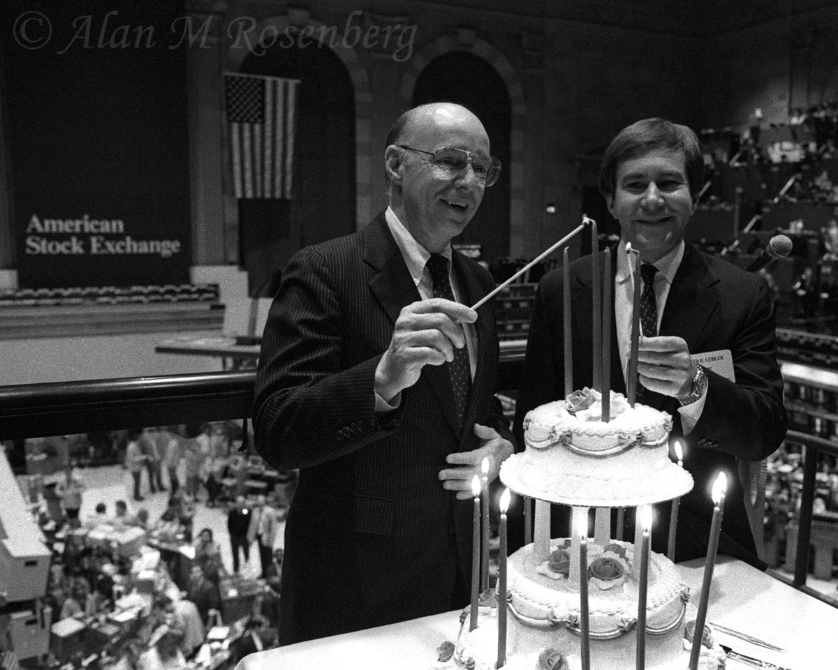 Jim Jones, AMEX Chairman and CEO (L) and AMEX President ,Ken Liebler light the cake celebrating the 15th year anniversary of Options Trading on the American Stock Exchange.