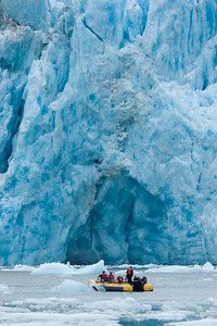 Rafters watch for calving ice off Dawes Glacier, Inside Passage, southeast Alaska.