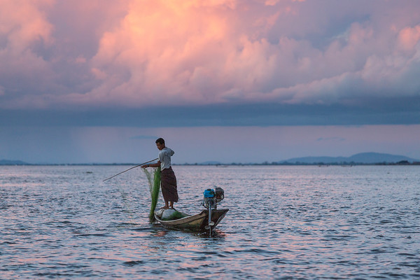 Fishing on Inle Lake at sunset, Myanmar.
