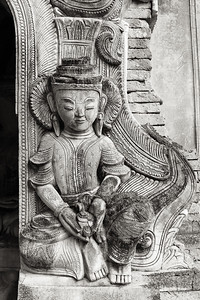 A god carved into stone on a stupa, Myanmar.
