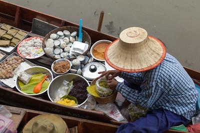Woman Vendor in Dugout Canoe