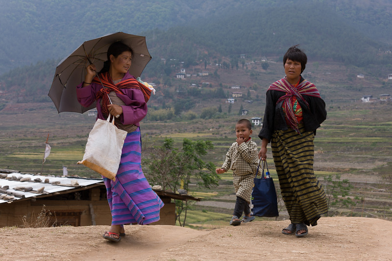 Young mothers walking with children, Bhutan.