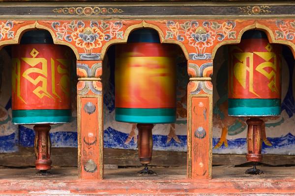 Prayer wheels spin at Kyichu Lhakhang temple, Bhutan.