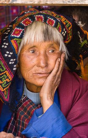 Woman watching festival, Bhutan.