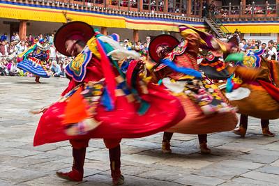 Monks dancing ceremonial dances, Bhutan.