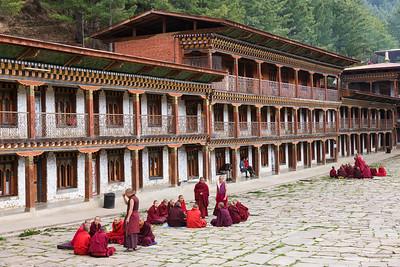 Monks in debate groups.