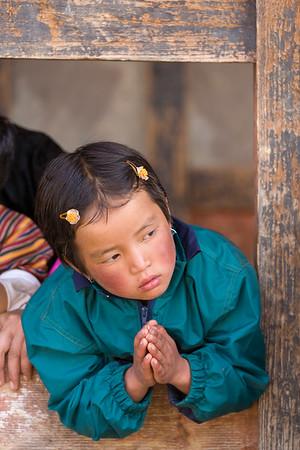 Devoted Bhutanese girl watching festival.