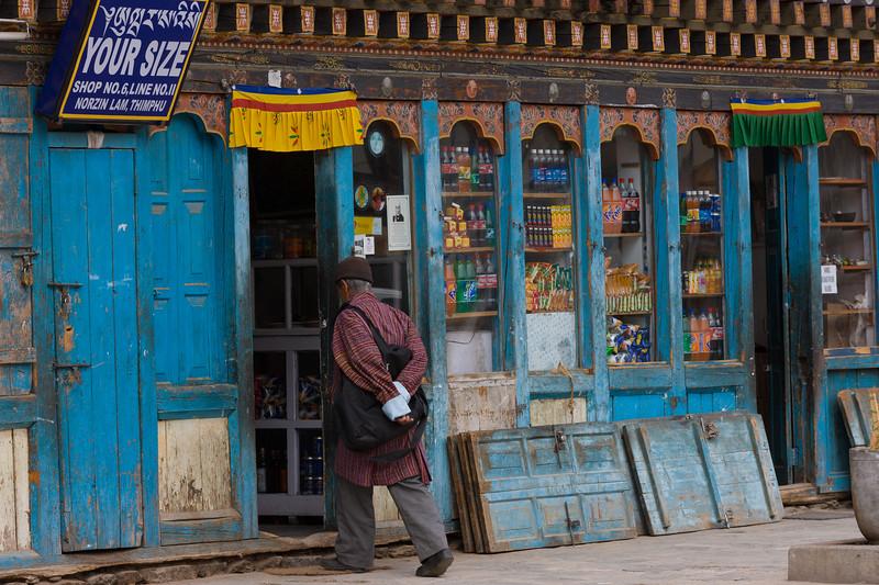 Man entering a shop in Bhutan.