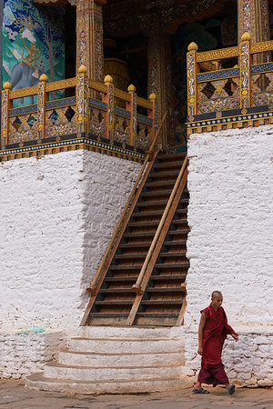 Monk and temple entrance, Punakha Dzong, Bhutan.