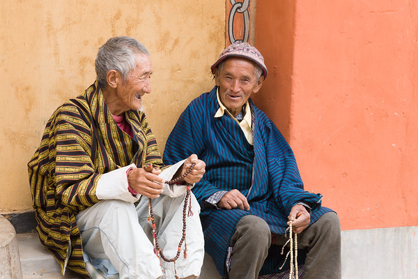 Old Men chatting outside temple, Thimphu, Bhutan