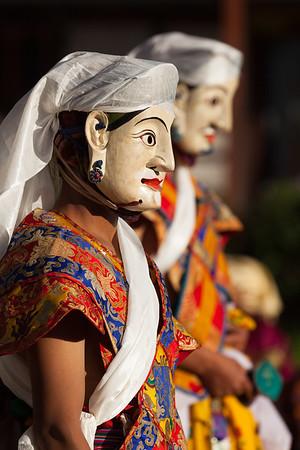Masked dancers at teschu, Bhutan.