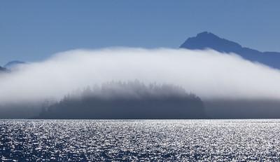 Fog cloud and island, British Columbia.