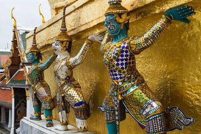 Yak demons support a gilded stupa in Wat Phra Kaew, Bangkok.