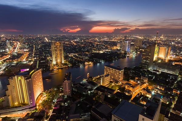 Bangkok skyline at sunset from above.
