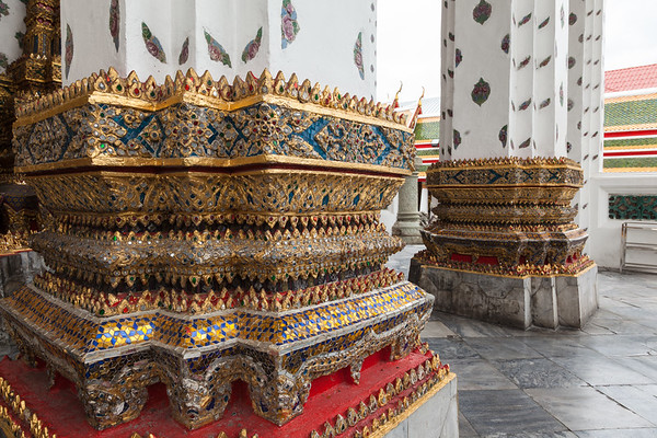 Pillars of gold, gemstones and colored tiles, Wat Arun, Bangkok.