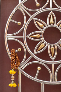 Flower Offering on temple door, Bangkok.
