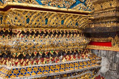 Pillars of gold, gemstones and colored tiles, Wat Arun, Bangkok.