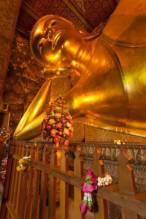Offering leis at Reclining Buddha, Bangkok.