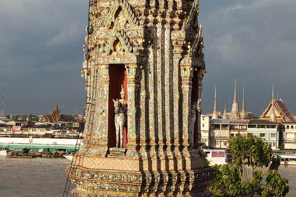 Wat Arun stupa and view of city across river, Bangkok.