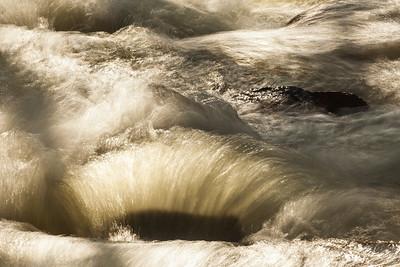Dappled light on flowing stream.