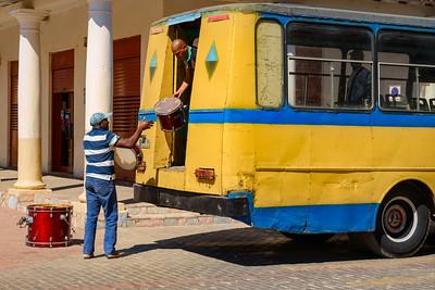 Musicians Unloading Gear