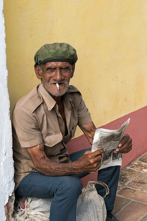 Man reading on Street, Trinidad.