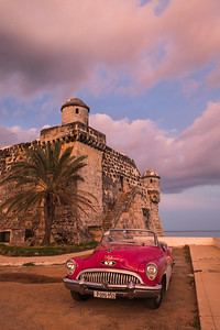 Classic Car and Fort at Sunset