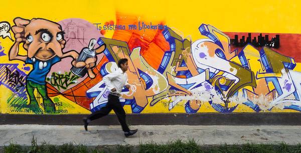 Running man and colorful mural, Mexico.