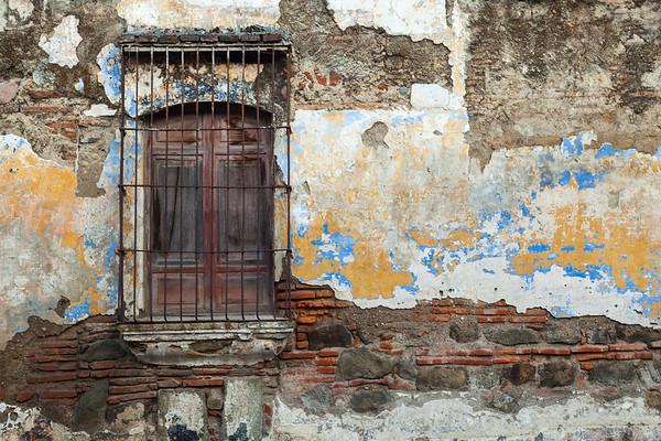 Shuttered window and decaying wall, Guatemala.
