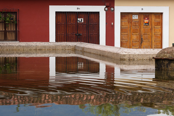 Reflections in public laundry pool, Antigua.