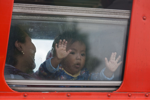 Child in Bus Window