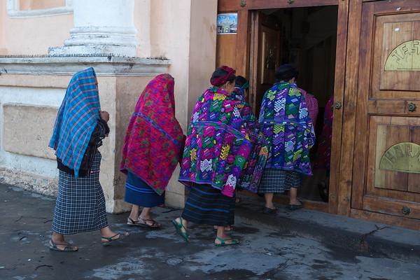 Women walking into church, Guatemala.