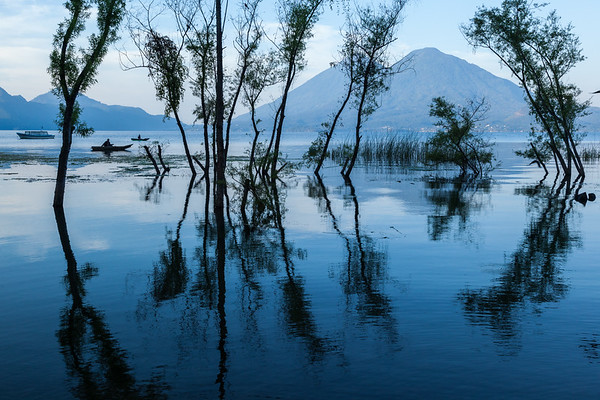 Fishermen and reflections in Lake Atitlán.