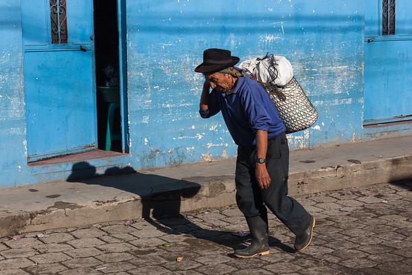Man, shadow and blue wall, Guatemala.