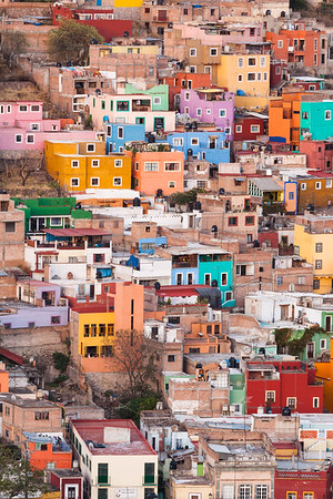 Mexico, Guanajuato. Colorful homes perch on the hillside of this Mexican town.