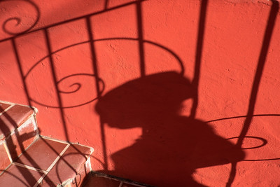 Shadow of woman and railing.